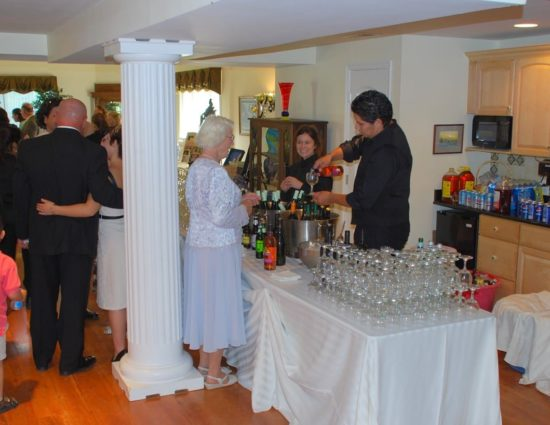 Wedding reception with people talking and standing at the bar