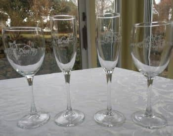 Four wine glasses with Briar Patch logo etched on them